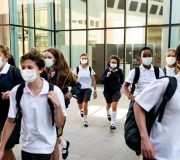 high-school-students-wearing-masks-on-their-way-home